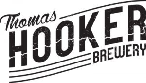 "black text in a slight banner shape that reads ""thomas hooker brewery"""